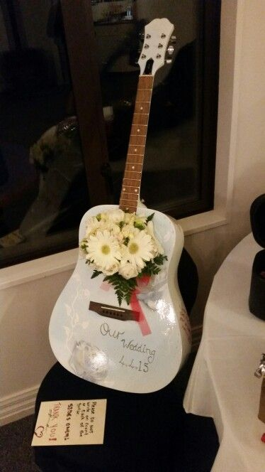 My gorgeous nieces wedding, airbrushing by Andrew Ross,Chch NZ. Guests were invited to sign the side of the guitar in red instead of a guest book. 4/4/15