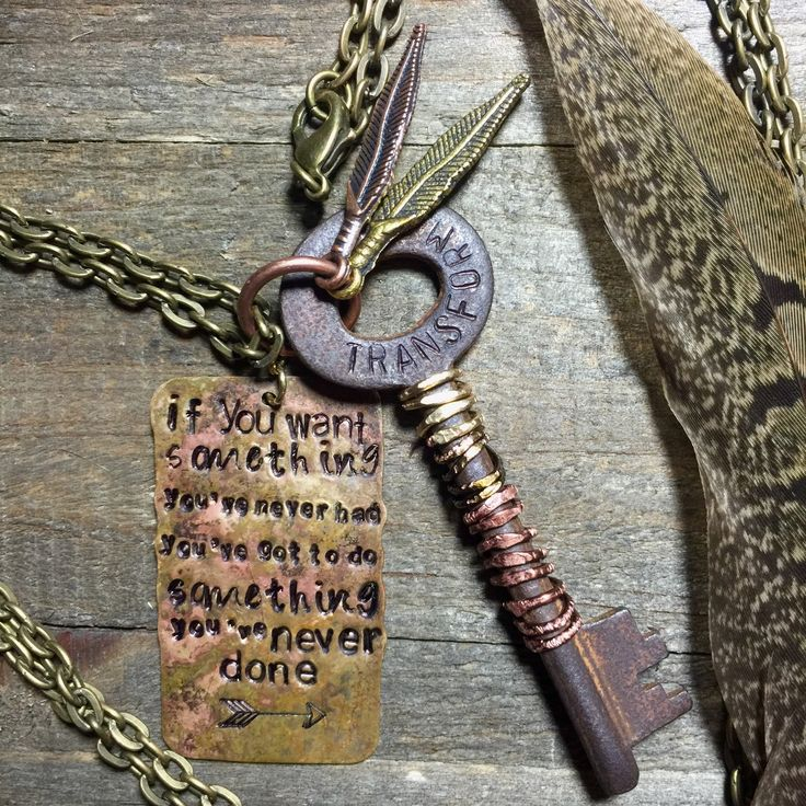 Hand stamped • iron skeleton key necklace keepsake • TRANSFORM • metal feathers • triple wire wrapped • stamped tag by FeathersandBrass on Etsy