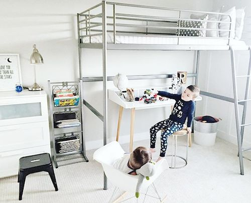 left shared kids room w 2 loft beds a play space between under