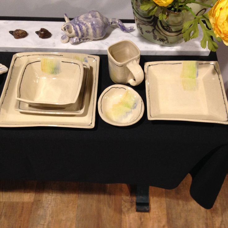 I'm making ivory dinnerware with an airy touch of yellow, chartreuse, light blue and black.