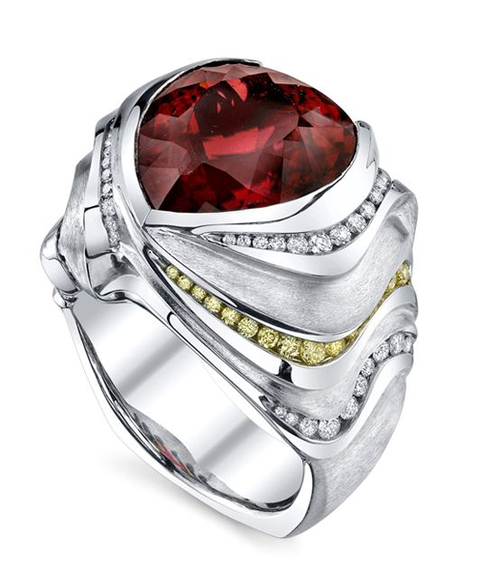 Platinum gents ring featuring a 15ct shield shaped rubellite tourmaline, accented with 0.90ctw of white diamonds and 0.225ctw of yellow diamonds.