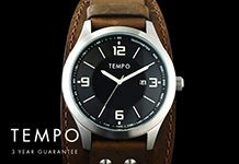 A black faced Tempo watch on a brown leather cuff.