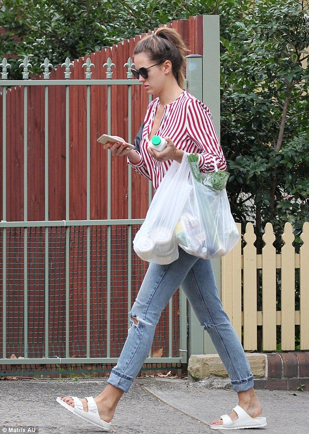 Cult favourites: She rounded off her look with a pair of white Birkenstock Arizona sandal...