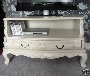 Take out dresser drawers for a vintage TV stand! Cute!