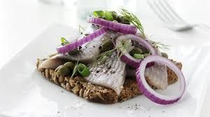Smorgasbord - herring with red onion on rye bread