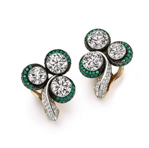 DIAMOND TREFOIL EARRINGS-Diamonds & Luck 6 round brilliant-cut diamonds, totalling 6.21 carats, 18k rose gold and 18k white gold with pavé-set diamonds and emeralds. | Sotheby's Diamonds