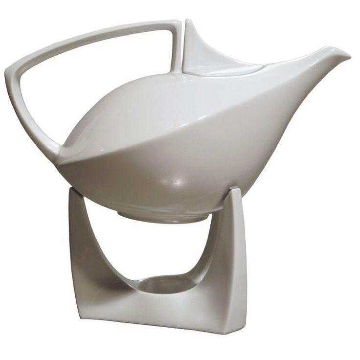 Ceramic teapot on stand