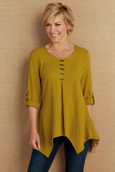 """Texturally interesting, our Celeste Tunic is sewn of crinkle gauze fabric, bracelet length sleeves with roll tab and accented with artistic details, like rectangular buttons descending from scoop neck. The pleat at center front and the trapezoid hem make this spectacular top an easy-to-wear option for every day. Polyester/rayon/spandex. Misses 28-1/2""""/32-1/2"""" long. Celeste Tunic #2AQ73"""
