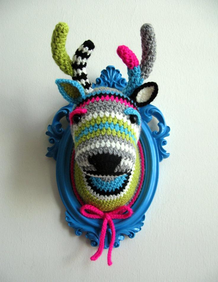 Crochet deer head in a wooden light blue frame.