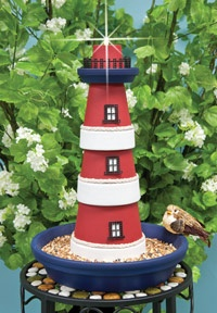 Terra cotta lighthouse. 3 clay pots, one small saucer for top, one large saucer for bottom, and a solar light on top. Paint it how you like and you have yourself a lighthouse bird feeder. LOVE