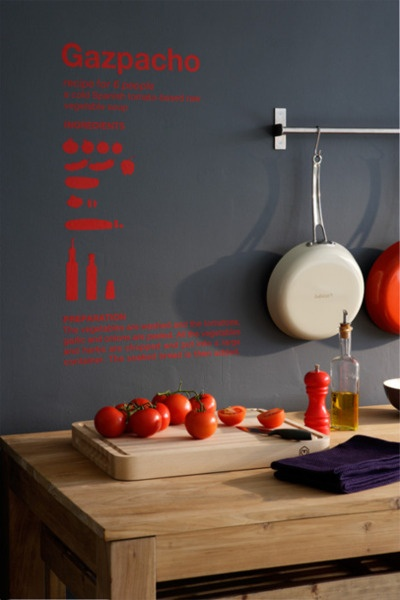 gazpacho recipe that's red typography on a grey wall
