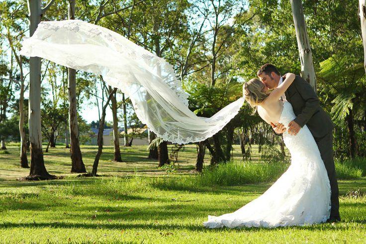 Bride & Groom + trees and veil