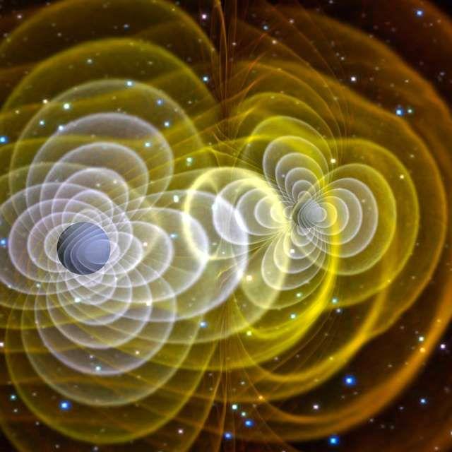 二つのブラックホール(球形の部分)が合体し、重力波が発生する様子のイメージ。コンピューターで再現した=NASA提供 - 朝日新聞