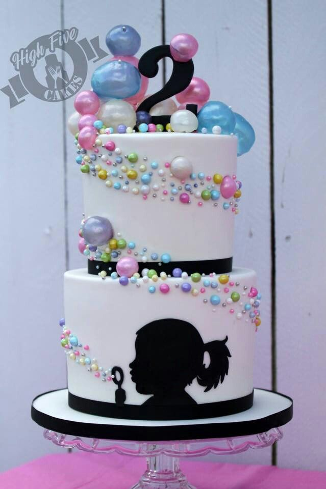 Girl blowing bubbles cake