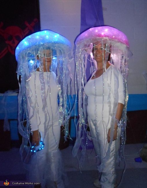 Glowing Jellyfish DIY costumes. But id want it to be around the top half of me and the head would stick out :P