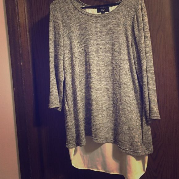 Super cute grey shirt Long sleeve light material with white sheer back drop. Never worn only took tags off Tops