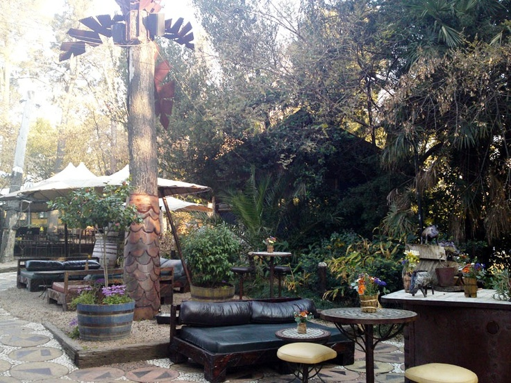 Moyo Restaurant at Zoo Lake in Johannesburg:  water trickling from beautiful fountains and deep sofas and cool muddled mint cocktails...heaven..