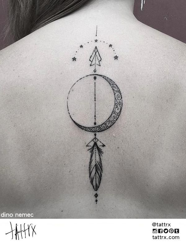 Awesome geometric tattoo of arrow and moon.