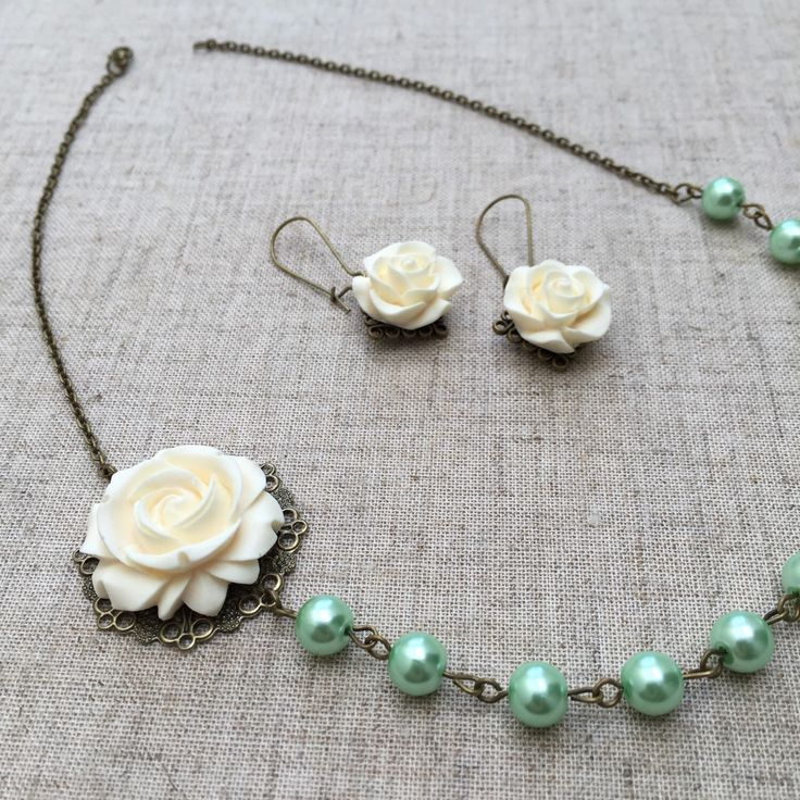 A personal favorite from my Etsy shop https://www.etsy.com/listing/231265787/mint-green-pearl-necklace-and-earrings