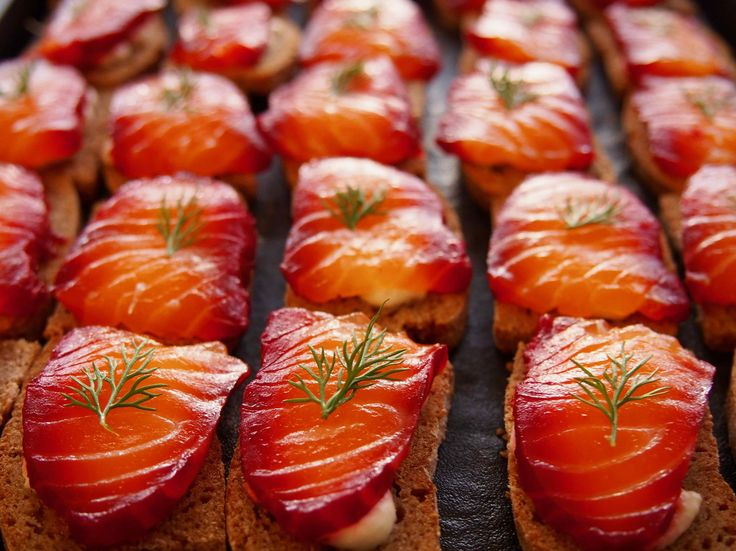 Beetroot-cured salmon on malt vinegar rye bread with horseradish cream canapé