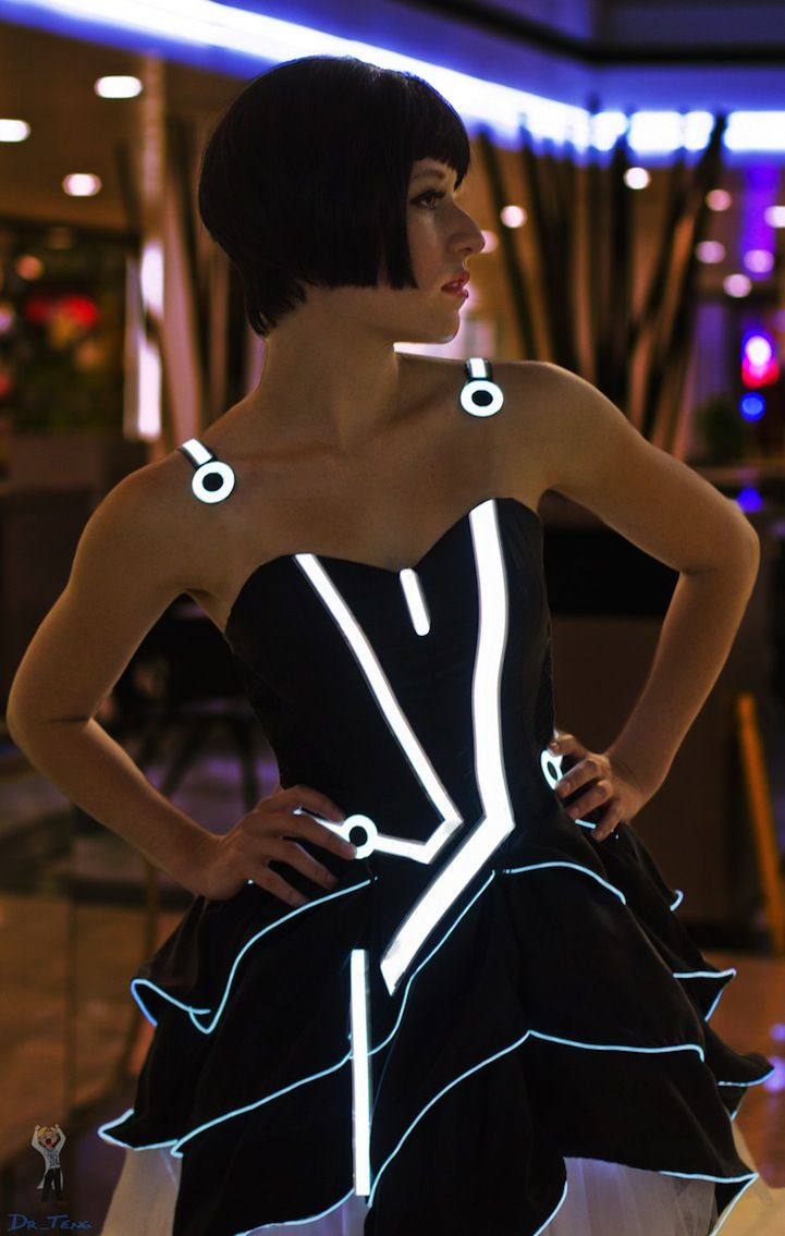 At San Diego Comic Con 2011, cosplayer Victoria Schmidt, better known as Scruffy Rebel, modeled this awesome Tron-themed outfit. Designed and constructed by Jin Yo, the costume is a re-imagining of the character Quorra's outfit as a party dress inspired by the styles of eccentric fashion designer Betsy Johnson.