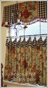 Cornice board valance with contrasting fabric, tassels and cafe curtain is truly custom.