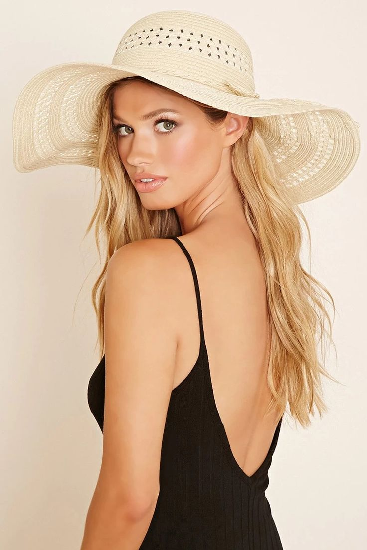 A floppy straw hat with a wide brim, semi-sheer panels throughout, and a braided bow ribbon on the crown. #accessorize