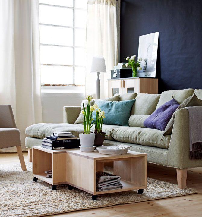 Norrgavel living - dark blue walls and light coloured furniture