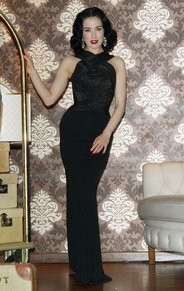 Dita Von Teese Evening Dress     Dita Von Teese showed off her kille rfigure at the My Cointreau Travel Essentials launch in a black curve-hugging evening gown.   Brand: Herve L. Leroux