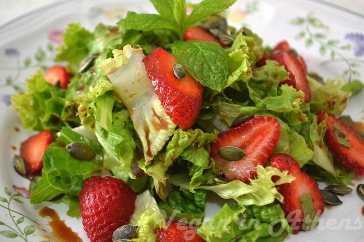Green salad with fresh strawberries & roasted pumpkin seeds
