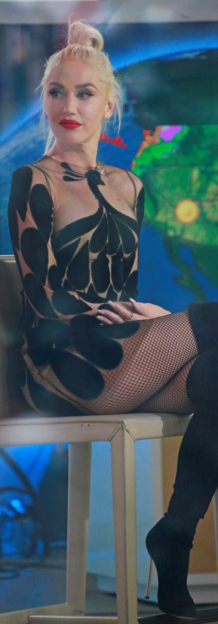 Who made Gwen Stefani's black thigh high boots and long sleeve dress?