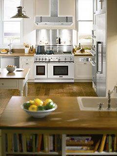 Traditional Thermador Professional kitchen featuring Freedom Refrigeraton, combo microwave, built-in oven and warming drawer, professional range, custom vent hood insert and professional dishwasher