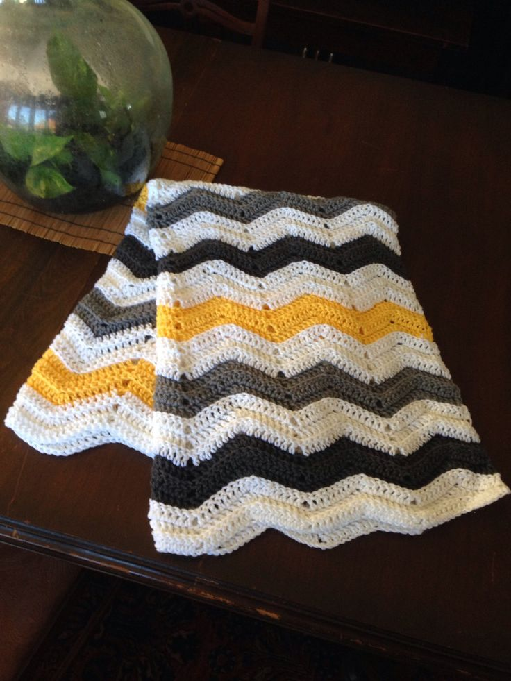 Yellow, Grey, and White Chevron Baby Afghan by BebeBoosBoutique on Etsy https://www.etsy.com/listing/490350525/yellow-grey-and-white-chevron-baby