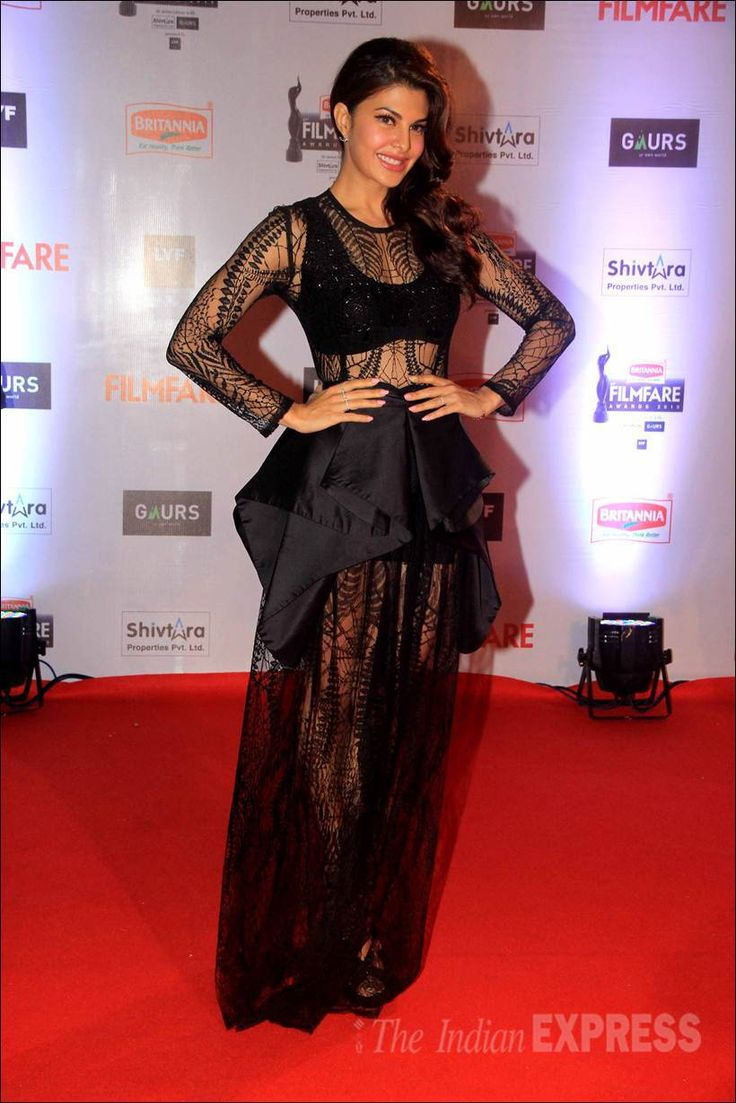 Jacqueline Fernandez in a sheer black dress on the red carpet at the Filmfare Awards show.