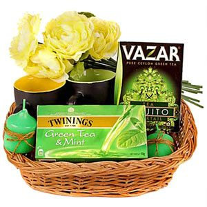 Hamper includes: Mojito flavoured green tea. Net weight: 100 grams. Twinings green tea. Contains: 25 tea bags. 4 artificial flowers. 2 candles. 2 black ceramic coffee mugs. Rs 1896/- http://www.tajonline.com/mothers-day-gifts/product/md1963/tea-with-a-mojito-twist/?aff=pint2014/
