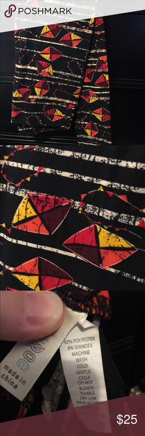 TC LuLaRoe Leggings Black background with orange, yellow and plum colored kites. Worn and washed once per LuLaRoe instructions. Like new. LuLaRoe Pants Leggings