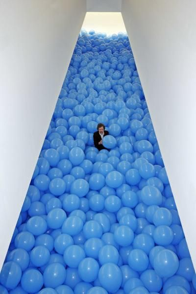 Martin Creed       idea for crossing the red sea - lots of blue balloons held back to teh sides and then fall down.  kids would love