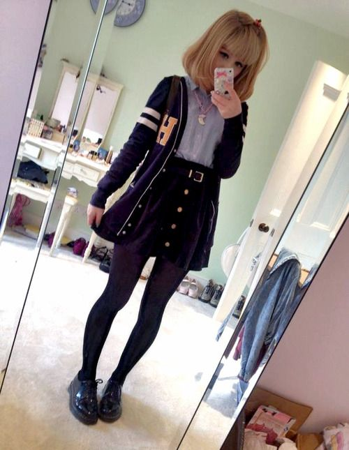 Very cute outfit with the black buttoned skirt, button-up top, cardigan, tights, and platforms.: