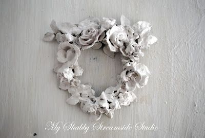 Pull the fake flowers apart and rearrange as a wreath with hot glue. Spray paint it white until all the color is gone. Mix a small batch of plaster of paris the texture of cream and paint on. Keep making fresh when it gets gooey. Let dry thoroughly, touch up and let dry again. This wreath is fragile