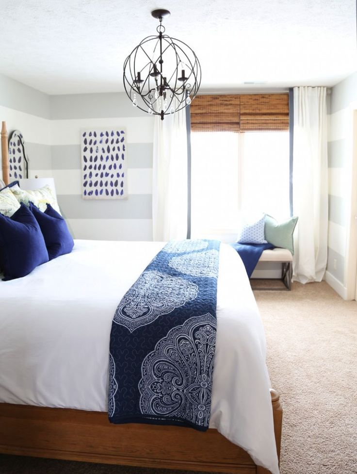 Guest Bedroom with Hickory Wood Bed and Linen Headboard, Orb Chandelier, bamboo shades and DIY white ribbon-trimmed drapes.