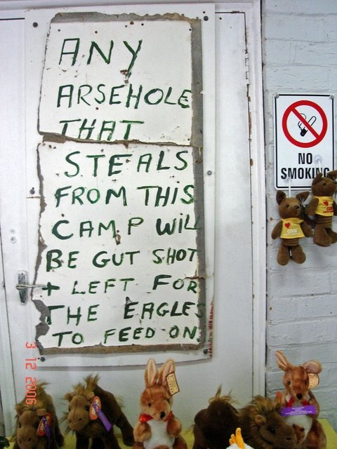 Sign on the Cook, South Australia, store, leaves no doubt in the mind of the fate of a person who steals from the store. (2006)