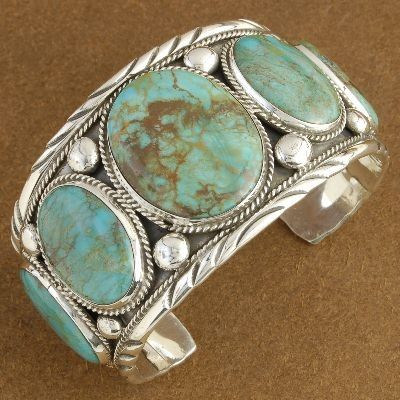 Sterling silver bracelet with 5 hand cut Manassa turquoise cabs by Verna Blackgoat (Navalo)