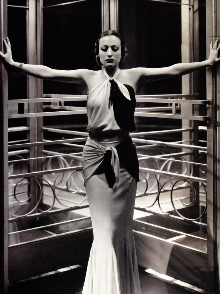 arms outstretched, high contrast (Joan Crawford)