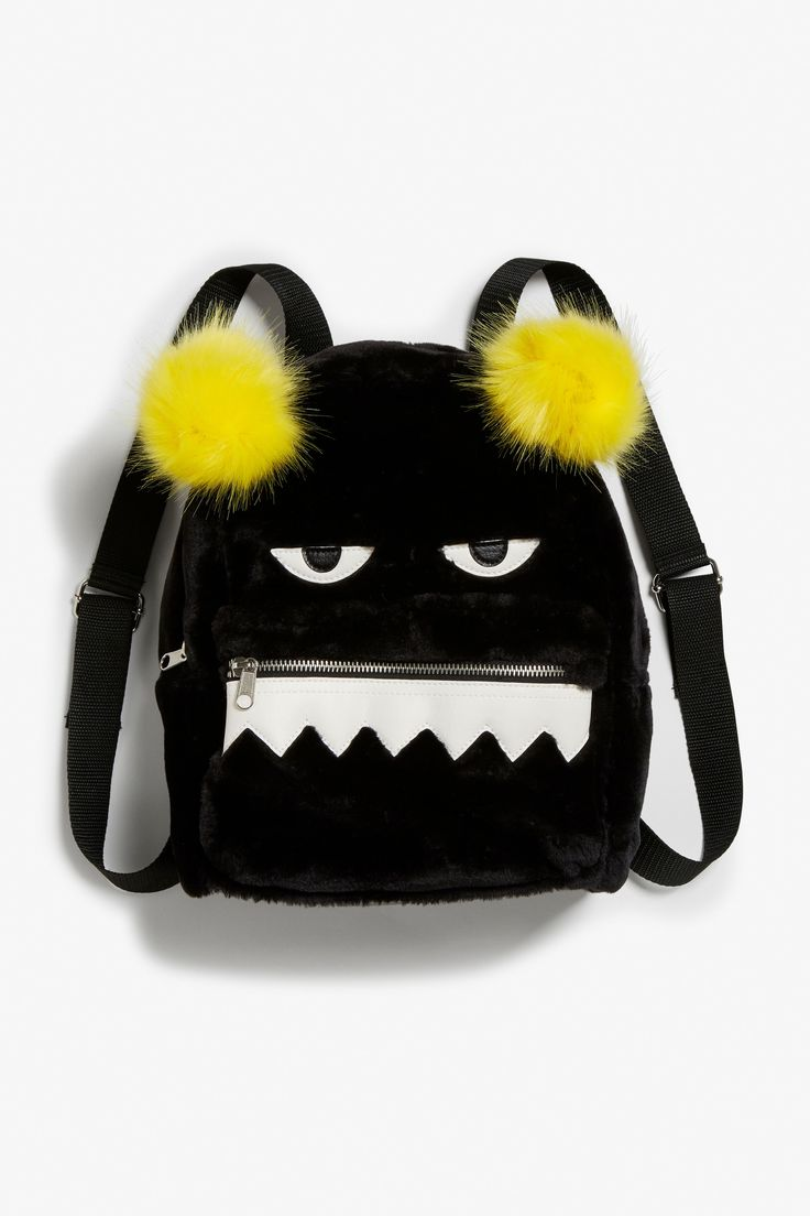 <p>This soft 'n' fluffy must-have Monki backpack has an upper main compartment and a smaller zip pocket – both with red inner fabric. Boom