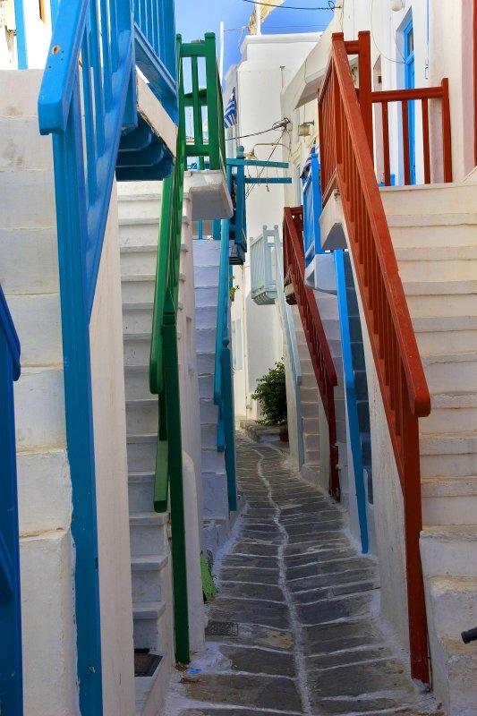 A narrow path through white steps in Mykonos, Greece