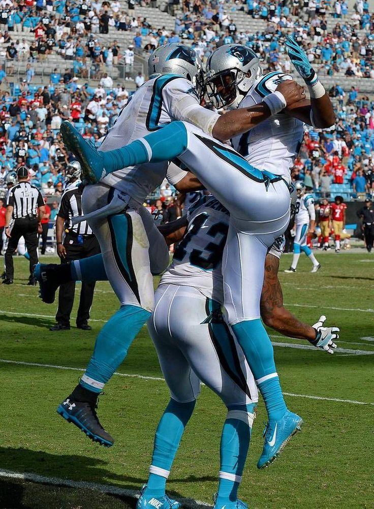 Carolina Panthers quarterback Cam Newton, left and wide receivers Kelvin…