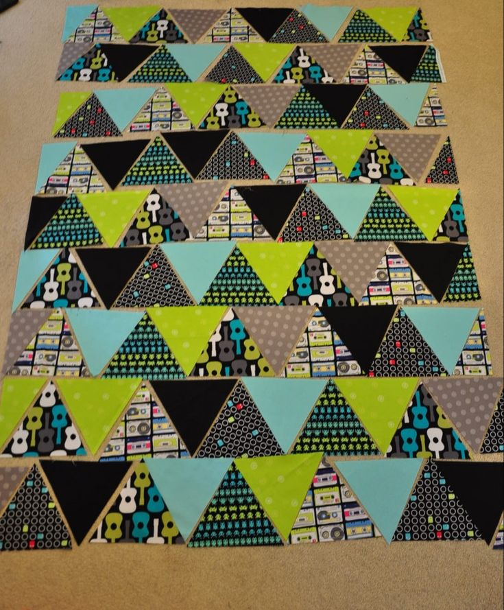 Trigangle quilt tutorial: from quiltylicious.co.uk  Posted for favequilts. 8 fat quarters, a triangle template, back fabric, wadding and the usual sewing paraphernalia. http://quiltylicious.co.uk/2013/07/01/triangle-quilt-tutorial/