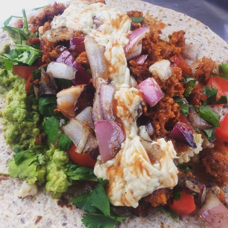 Gypsy Burrito featuring Chipotle Field Roast, Daiya Dairy Free Mozzarella, Guacamole, Tomatoes, Grilled Red Onion, Cilantro, Franks Hot Sauce, Brown Rice & Black Beans YUMMMMMM. Check our website for our schedule to come get one!!