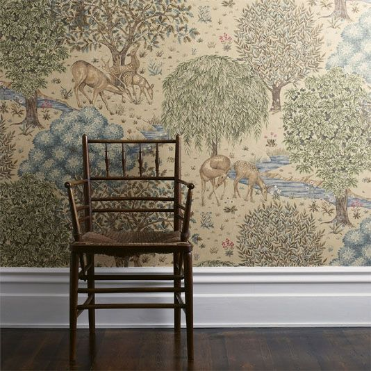 The Brook Wallpaper 'The Brook' on a dark blue background is inspired by medieval tapestries. This has been newly created by Morris & Co.'s designer Alison Gee.