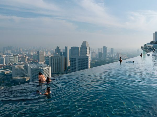 """The vertiginous """"infinity pool"""" at the Marina Bay Sands resort offers a sweeping view of Singapore"""